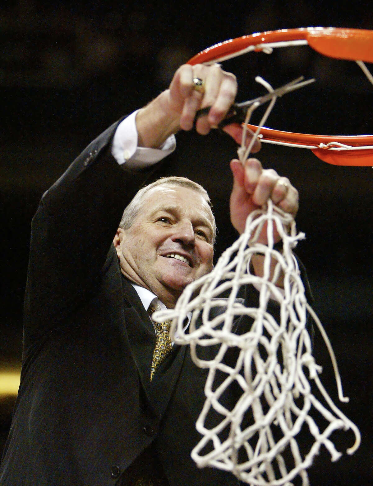 Connecticut coach Jim Calhoun cuts down the net at the NCAA Phoenix Regional Finals, Saturday, March 27, 2004. Connecticut beat Alabama, 87-71, to proceed to the Final Four.