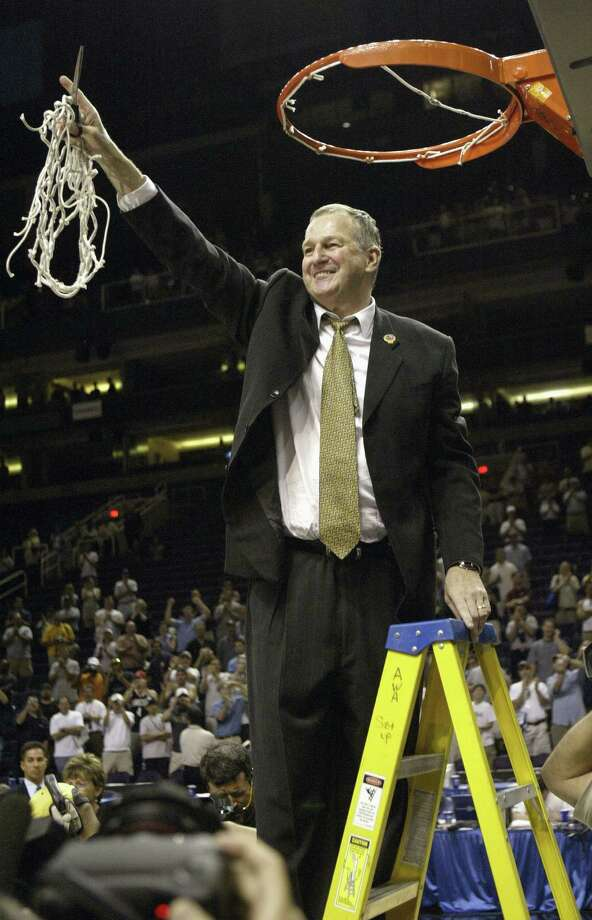 Head coach Jim Calhoun of the University of Connecticut Huskies cuts down the net after the fourth round of the NCAA Division I Men's Basketball Tournament against the Alabama Crimson Tide at America West Arena on March 27, 2004 in Phoenix, Arizona. UConn defeated Alabama 87-71. Photo: Stephen Dunn, Stephen Dunn/Getty Images / 2004 Getty Images
