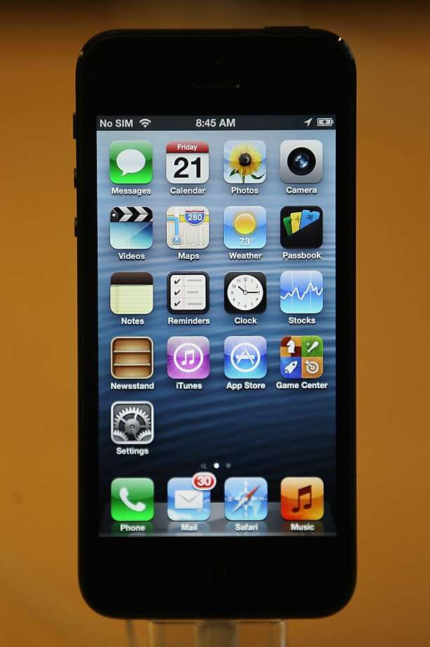 The larger screen of the iPhone 5 allows display of a fifth row of icons. Photo: Mario Tama, Getty Images