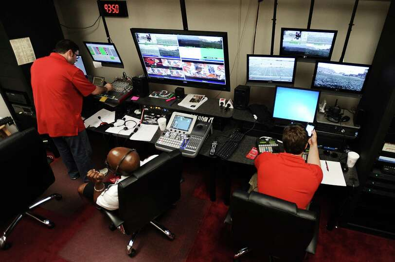 The Lamar football scoreboard is operated from inside a windowless room inside the Montagne Center.