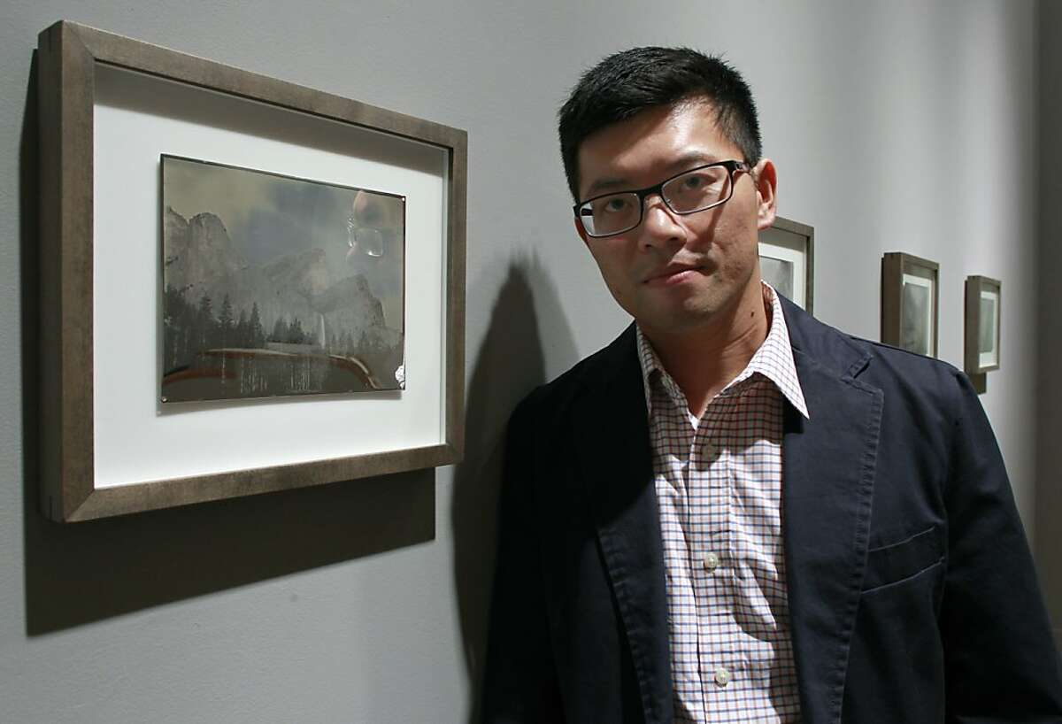 Photographer Binh Danh views an exhibit of his daguerreotype Yosemite photographs at the Haines Gallery in San Francisco, Calif. on Saturday, Sept. 8, 2012.