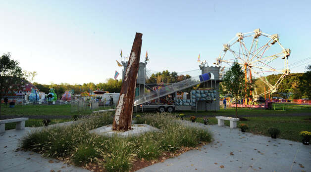 Ridgefield's 9/11 memorial sits right next to a carnival sponsored by the Ridgefield Chamber of Commerce Friday, Sept. 21, 2012. Photo: Carol Kaliff / The News-Times