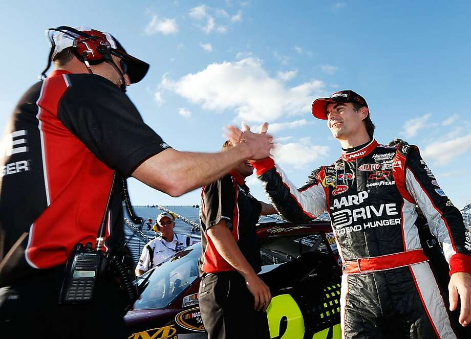 Crew chief Alan Gustafson (left) congratulates Jeff Gordon, whose 134.911-mph lap in qualifying won Sunday's pole in Loudon, N.H. Photo: Jamie Squire, Getty Images