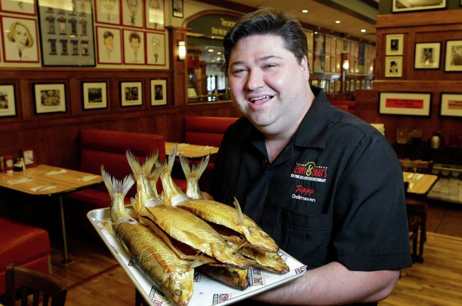 Ziggy Gruber, owner of Kenny and Ziggy's deli in the Galleria area, says whitefish such as these are hard to come by due to warm temperatures in the Great Lakes. Photo: Melissa Phillip / © 2012 Houston Chronicle