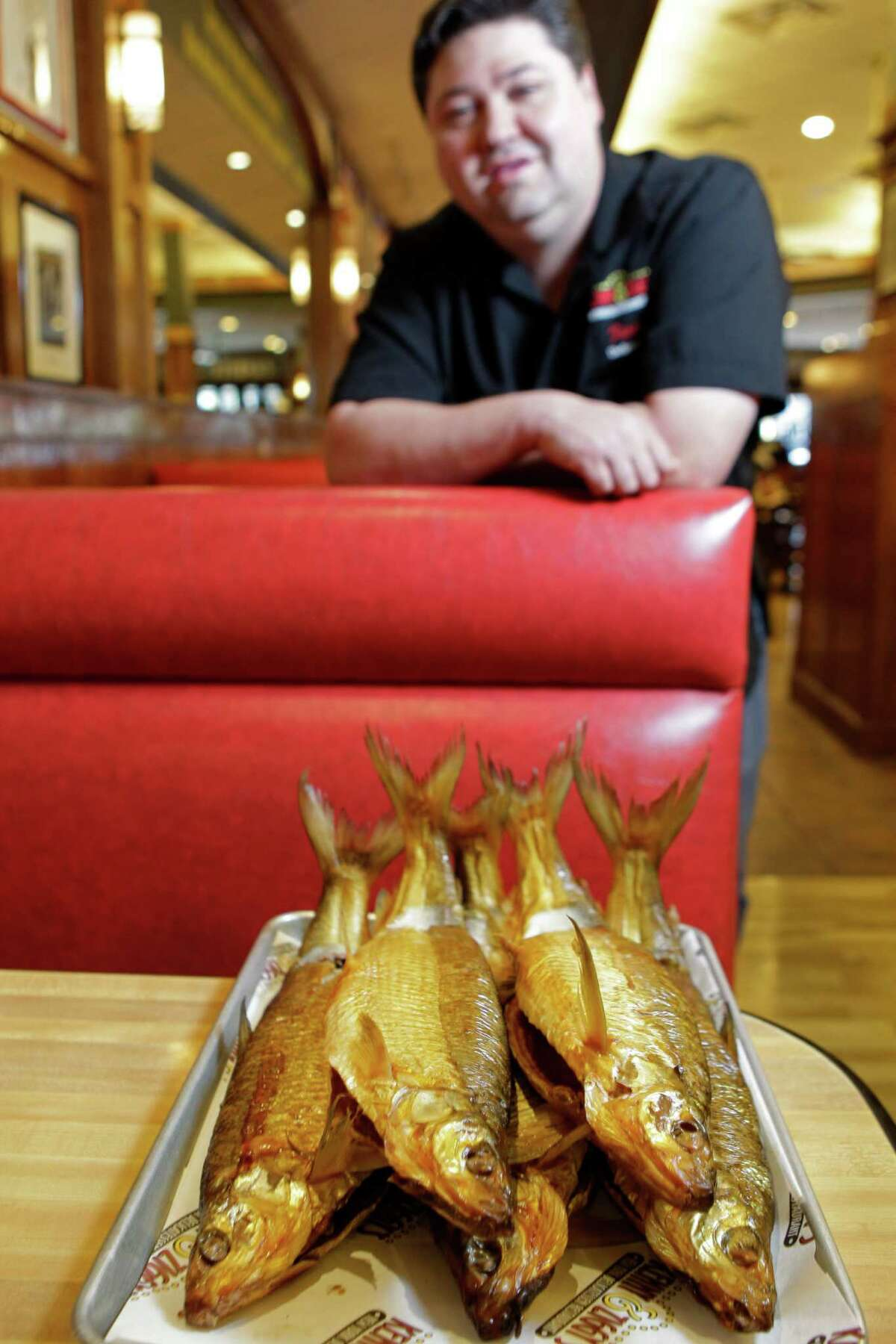 Ziggy Gruber, owner of Kenny and Ziggy's, 2327 Post Oak Blvd., poses with a tray of white fish, Thursday, Sept. 20, 2012, in Houston. ( Melissa Phillip / Houston Chronicle )