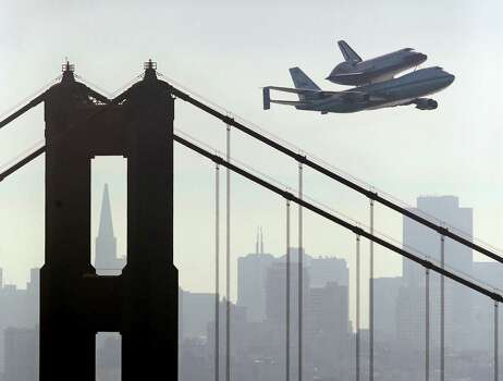 Space Shuttle Endeavour mounted on NASA's Shuttle Carrier Aircraft,  passes over the Golden Gate Bridge in San Francisco,  Friday, Sept. 21, 2012.  Endeavour is making a final trek across the country to the California Science Center in Los Angeles, where it will be permanently displayed. Photo: Marcio Jose Sanchez, Associated Press / AP