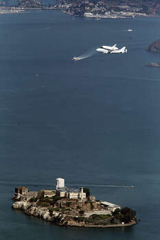 The space shuttle Endeavour makes a pass over Alcatraz during its tour over the Bay Area on Friday, September 21, 2012 in San Francisco, California. Photo: Anda Chu, Oakland Tribune / Oakland Tribune