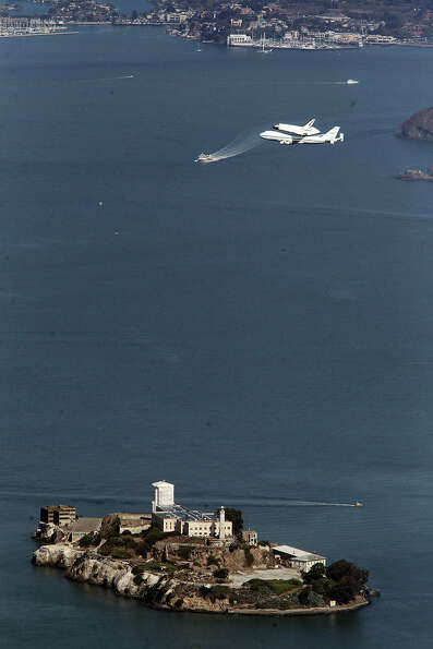 The space shuttle Endeavour makes a pass over Alcatraz during its tour over the Bay Area on Friday,