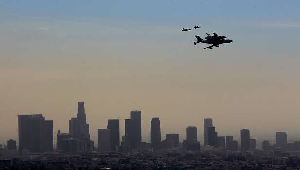 The space shuttle Endeavour flies over the downtown Los Angeles skyline September 21 2012 in Los Angeles, California. The shuttle is scheduled to land at LAX Friday afternoon. Photo: Brian Van Der Brug, McClatchy-Tribune News Service / Los Angeles Times