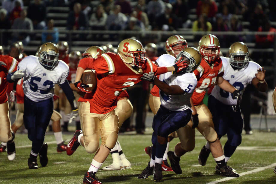 Stratford ball carrier Sam Breiner (3) stiff arms Notre Dame Fairfield's Jalani Roman (5) during the football game at Bunnell High School in Stratford on Friday, Sept. 21, 2012. Photo: Amy Mortensen / Connecticut Post Freelance