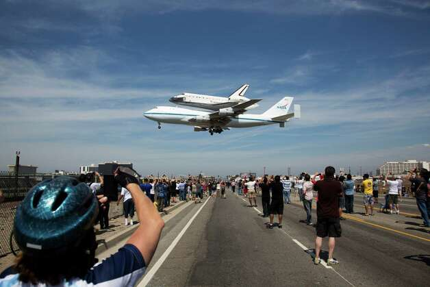In this photo provided by NASA, the Space Shuttle Endeavour atop a modified 747 lands at Los Angeles International Airport on Friday, Sept. 21, 2012 in Los Angeles. Endeavour will be permanently displayed at the California Science Center in Los Angeles. (AP Photo/NASA, Matt Hedges) Photo: Matt Hedges