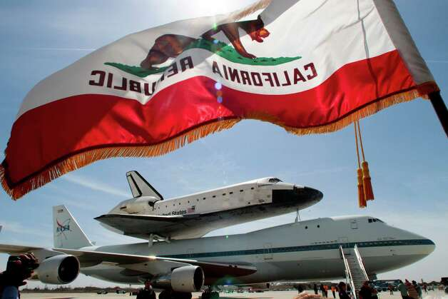 the Space Shuttle Endeavour atop a modified 747 arrives at Los Angeles International Airport on Friday, Sept. 21, 2012 in Los Angeles. Endeavour will be permanently displayed at the California Science Center in Los Angeles. (AP Photo/Los Angeles Times, Anne Cusack)  NO FORNS; NO SALES; MAGS OUT; ORANGE COUNTY REGISTER OUT; LOS ANGELES DAILY NEWS OUT; VENTURA COUNTY STAR OUT; INLAND VALLEY DAILY BULLETIN OUT; MANDATORY CREDIT, TV OUT Photo: Anne Cusack
