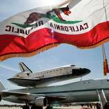 the Space Shuttle Endeavour atop a modified 747 arrives at Los Angeles International Airport on Friday, Sept. 21, 2012 in Los Angeles. Endeavour will be permanently displayed at the California Science Center in Los Angeles. (AP Photo/Los Angeles Times, Anne Cusack)  NO FORNS; NO SALES; MAGS OUT; ORANGE COUNTY REGISTER OUT; LOS ANGELES DAILY NEWS OUT; VENTURA COUNTY STAR OUT; INLAND VALLEY DAILY BULLETIN OUT; MANDATORY CREDIT, TV OUT