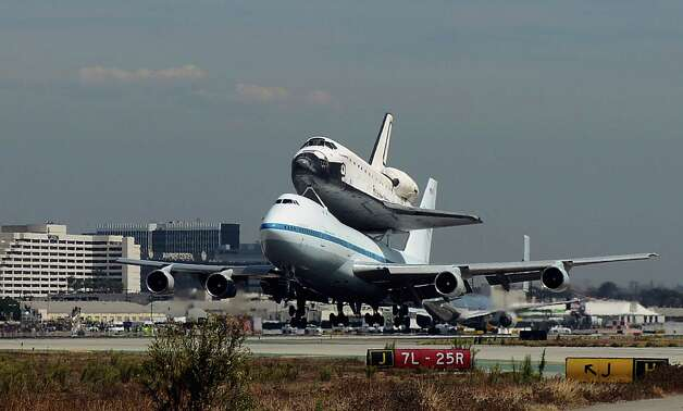 The Space Shuttle Endeavour atop a modified 747  lands at Los Angeles International Airport on Friday, Sept. 21, 2012 in Los Angeles, Endeavour will be permanently displayed at the California Science Center in Los Angeles. (AP Photo/Kevork Djansezian, Pool) Photo: Kevork Djansezian