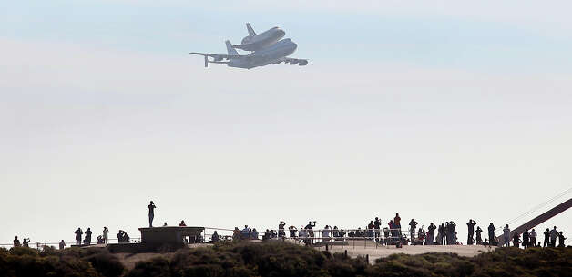 The Space Shuttle Endeavour atop a modified 747 flies by the north tower over the Marin Headlands at the Golden Gate Bridge in San Francisco, Friday Sept. 21, 2012.  Endeavour is making a final trek across the country to the California Science Center in Los Angeles, where it will be permanently displayed. (AP Photo/The Press Democrat, Kent Porter) Photo: Kent Porter