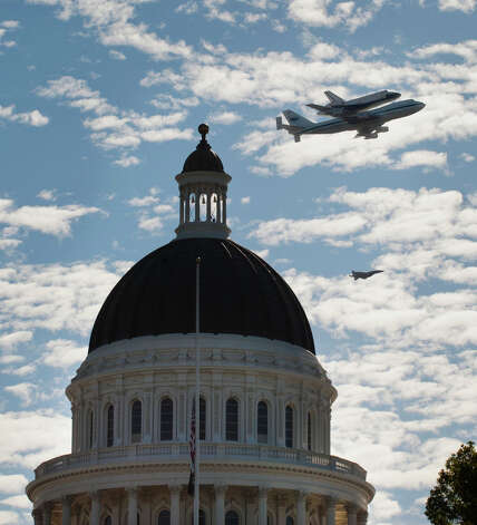 Space Shuttle Endeavour mounted on NASA's Shuttle Carrier Aircraft, passes over the California state Capitol, Friday, Sept. 21, 2012,  in Sacramento, Calif. Endeavour is making a final trek across the country to the California Science Center in Los Angeles, where it will be permanently displayed.(AP Photo/The Sacramento Bee, Lezlie Sterling)  MAGS OUT; LOCAL TV OUT (KCRA3, KXTV10, KOVR13, KUVS19, KMAZ31, KTXL40); MANDATORY CREDIT Photo: Lezlie Sterling