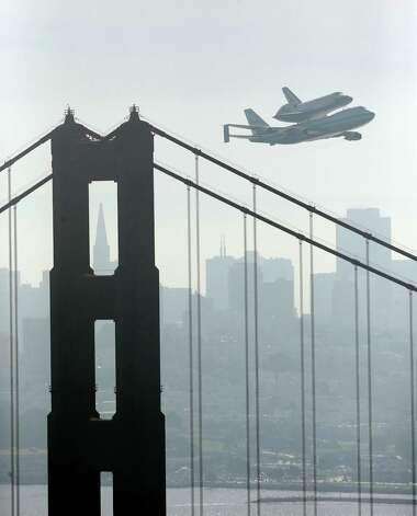 Space Shuttle Endeavour mounted on NASA's Shuttle Carrier Aircraft, passes over the Golden Gate Bridge in San Francisco,  Friday, Sept. 21, 2012.  Endeavour is making a final trek across the country to the California Science Center in Los Angeles, where it will be permanently displayed.  (AP Photo/Marcio Jose Sanchez) Photo: Marcio Jose Sanchez