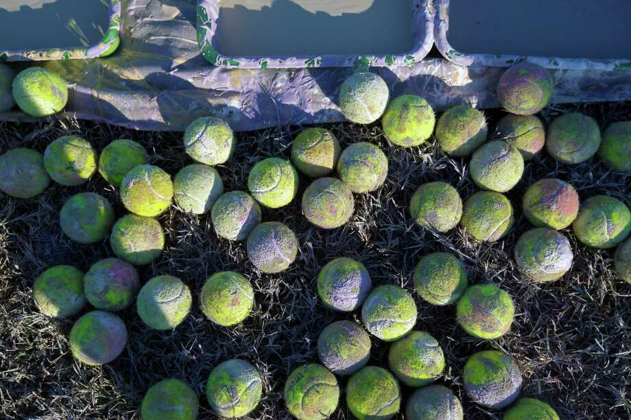 Used tennis balls coated with white paint are seen, Friday, September 21, 2012 during an event in association with the Zina Garrison Academy, at KIPP Academy in Houston, Texas. Photo: TODD SPOTH, TODD SPOTH / PHOTOGRAPHER / © TODD SPOTH, 2012