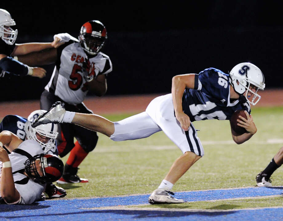 Staples quarterback Jack Massie # 16 dives for extra yardage during high school football game between Staples High School and Bridgeport Central High School at Staples in Westport, Friday night, Sept. 21, 2012. Photo: Bob Luckey / Greenwich Time