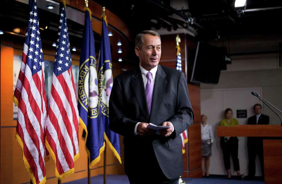 Speaker of the House John Boehner, R-Ohio, smiles as he leaves a news conference as Congress prepares to shut down until after the elections in November, on Capitol Hill in Washington, Friday, Sept. 21, 2012. (AP Photo/J. Scott Applewhite) Photo: J. Scott Applewhite