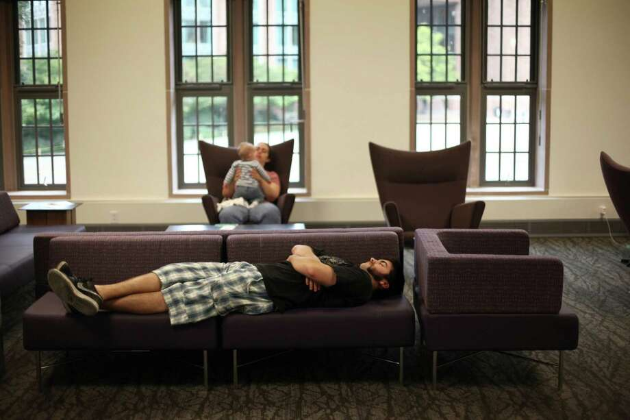 A student sleeps in the newly remodeled HUB. Photo: JOSHUA TRUJILLO / SEATTLEPI.COM