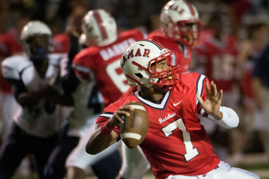 Lamar quarterback Darrell Colbert (7) throws a deep pass during the second quarter of a high school football game against Elsik at Delmar Stadium, Friday, Sept. 21, 2012, in Houston. Photo: Smiley N. Pool, Houston Chronicle / © 2012  Houston Chronicle