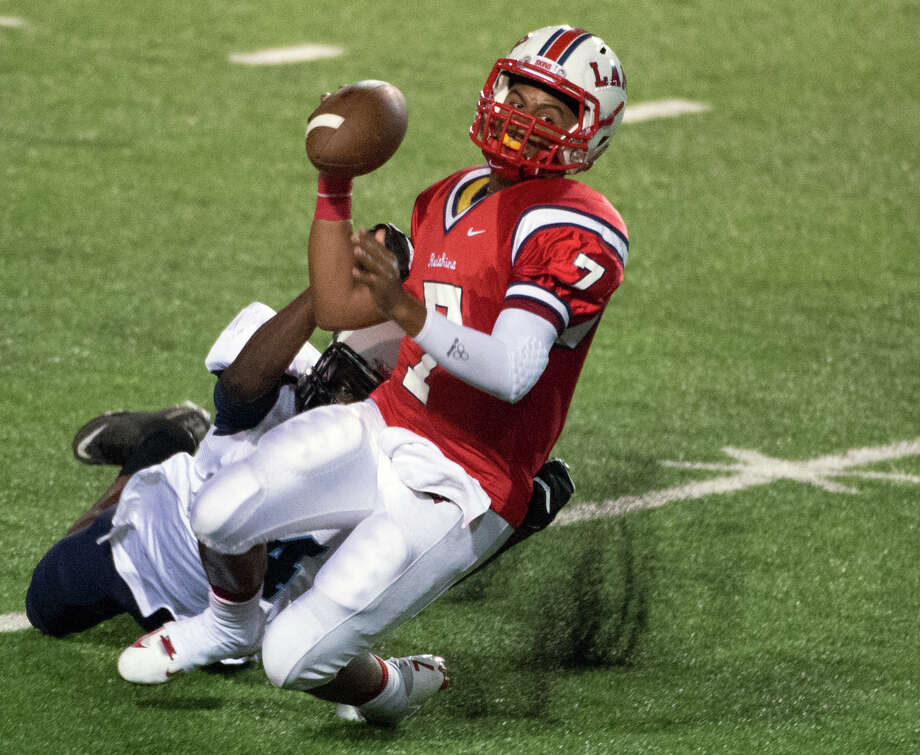 Lamar quarterback Darrell Colbert (7) is sacked by Elsik linebacker Emmanuel Allumanah (44) during the second quarter of a high school football game at Delmar Stadium, Friday, Sept. 21, 2012, in Houston. Photo: Smiley N. Pool, Houston Chronicle / © 2012  Houston Chronicle