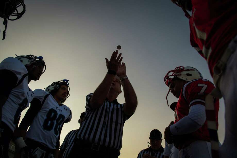 Referee Mike Alsobrooks performs the pre game coin toss before a high school football game between Lamar and Elsik at Delmar Stadium, Saturday, Sept. 22, 2012, in Houston. Photo: Smiley N. Pool, Houston Chronicle / © 2012  Houston Chronicle