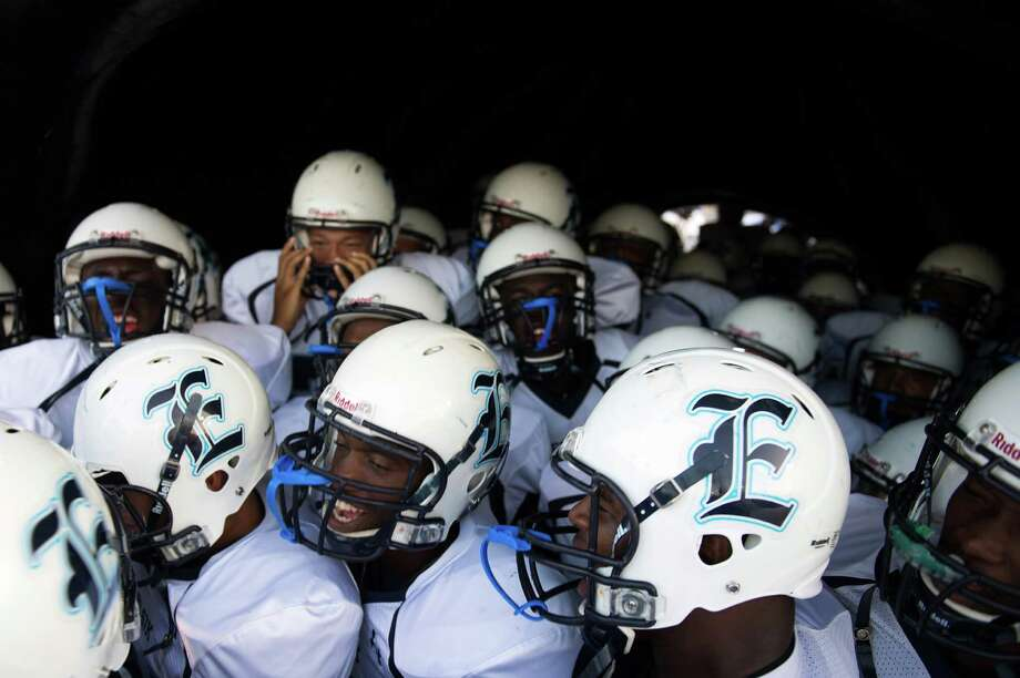 Elsik players prepare to take the field before facing Lamar in a high school football game at Delmar Stadium, Friday, Sept. 21, 2012, in Houston. Photo: Smiley N. Pool, Houston Chronicle / © 2012  Houston Chronicle