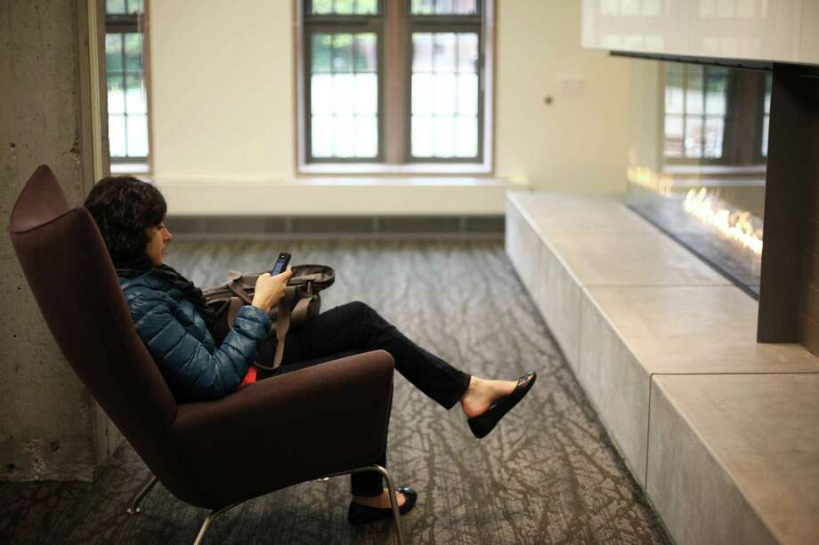 Communications senior Rachel Sofferin relaxes by a fire in the newly remodeled HUB. Photo: JOSHUA TRUJILLO / SEATTLEPI.COM