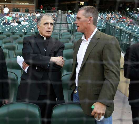Craig Biggio chats with Cardinal Daniel DiNardo before the start of an MLB baseball game at Minute Maid Park on Friday, Sept. 21, 2012, in Houston. Photo: Karen Warren, Houston Chronicle / © 2012  Houston Chronicle