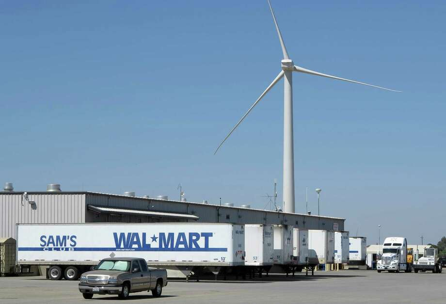 "A wind turbine outside of a Walmart distribution center in Red Bluff, Calif, Sept. 11, 2012. A proposal to renew a federal tax credit created to encourage ""green power"" development is hung up in Congress, jeopardizing growth of the business, experts say. (The New York Times) Photo: New York Times / NYTNS"