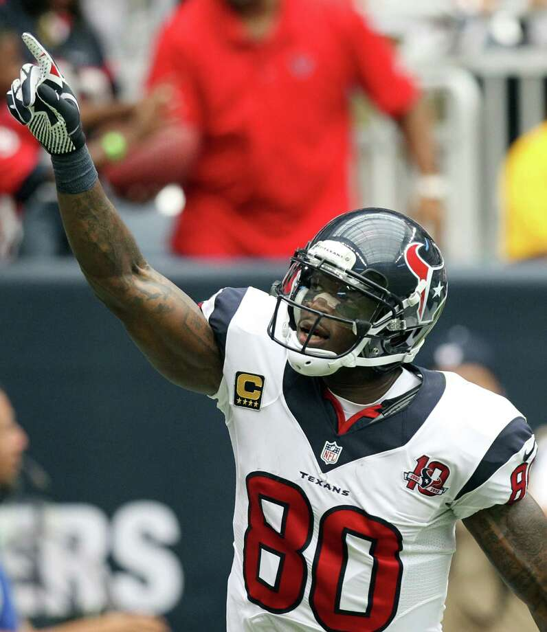 Houston Texans wide receiver Andre Johnson celebrates after catching a touchdown pass against the Miami Dolphins during the second quarter at Reliant Stadium, Sunday, Sept. 9, 2012, in Houston. Photo: Nick De La Torre, Houston Chronicle / © 2012  Houston Chronicle