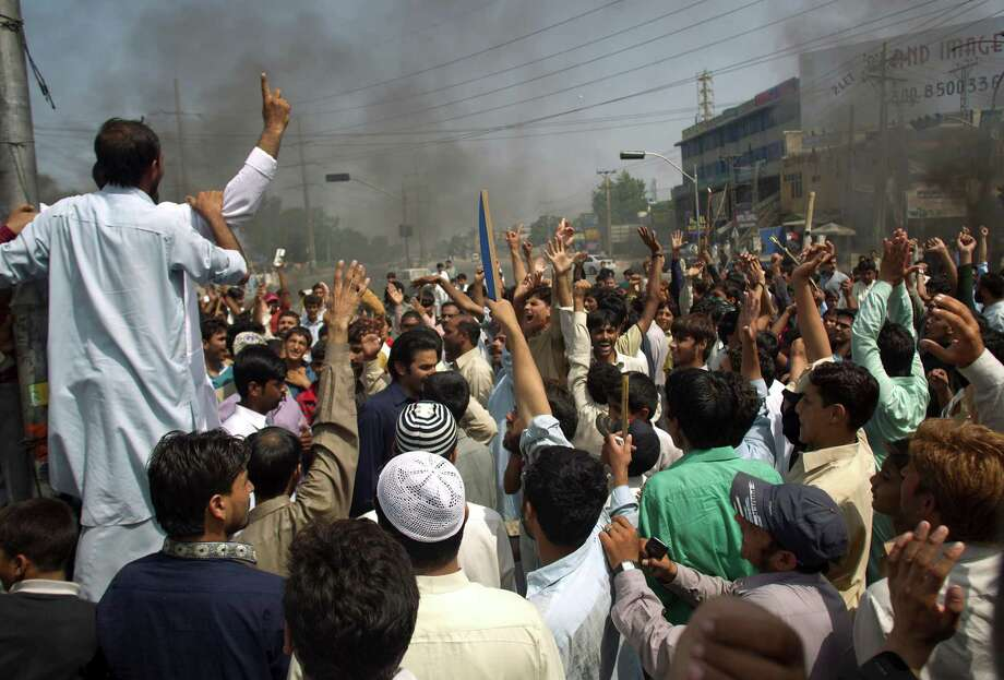 Pakistani protesters shout anti-U.S. slogans at a rally in Rawalpindi, Pakistan on Friday, Sept. 21, 2012. Pakistan has blocked cell phone service in major cities to prevent militants from using phones to detonate bombs during a national day of protest against an anti-Islam film produced in the United States. (AP Photo/B.K. Bangash) Photo: B.K. Bangash