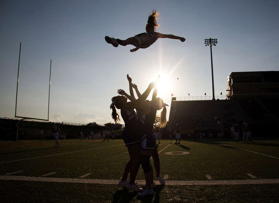 Dickinson High cheerleaders go through warm-ups before the Dickinson, Deer Park football game at Clyde Abshier Stadium on Friday, Sept. 21, 2012, in Deer Park. Photo: Joe Buvid, For The Chronicle / © 2012 Joe Buvid