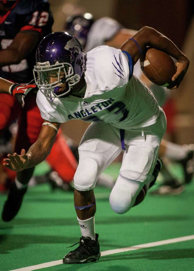 Angleton tailback Joshawa West (23) runs with the ball during the second quarter of a high school football game at Crump Stadium on Friday, Sept. 21, 2012, in Houston. Photo: Andrew Richardson, For The Chronicle / © 2012 Andrew Richardson