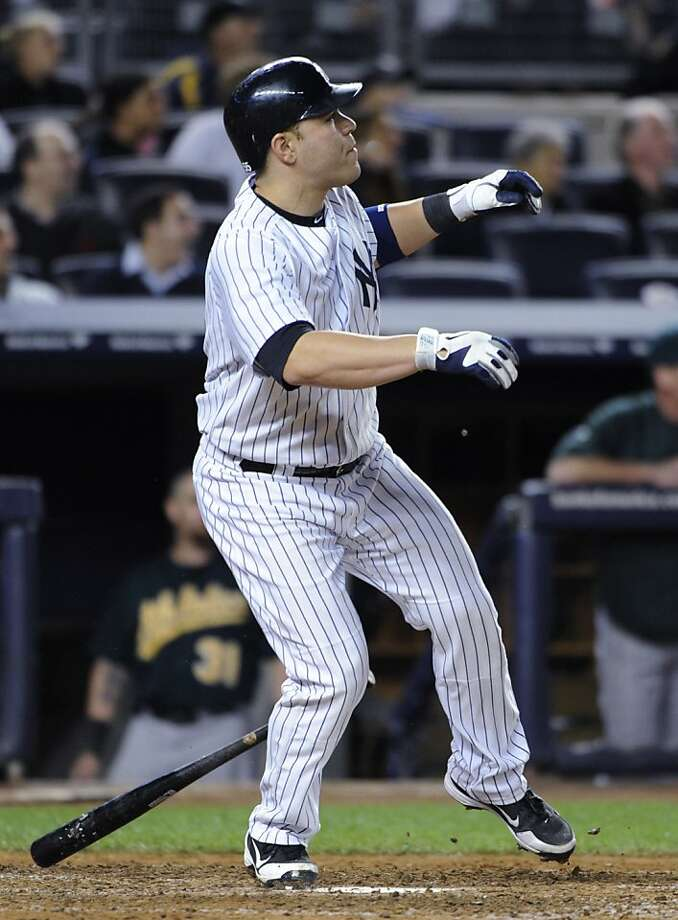 The Yankees' Russell Martin wins the game with a solo homer in the 10th. Photo: Kathy Kmonicek, Associated Press