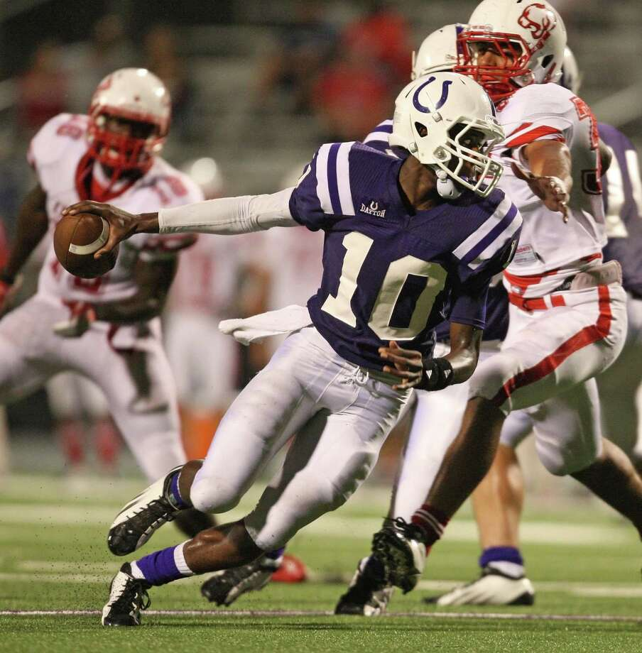 Dayton quarterback Markain Chambers (10) escapes a sack by Crosby's Nathan Caldwell during the first half of a high school football game, Friday, September 21, 2012 at Bronco Stadium in Dayton, TX. Photo: Eric Christian Smith, For The Chronicle