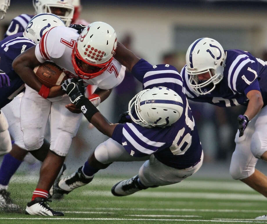 Crosby quarterback Aston Walter (7) is tackled by Dayton's Jamaud St. Andre (22) and Charles Tousant (60) during the first half of a high school football game, Friday, September 21, 2012 at Bronco Stadium in Dayton, TX. Photo: Eric Christian Smith, For The Chronicle