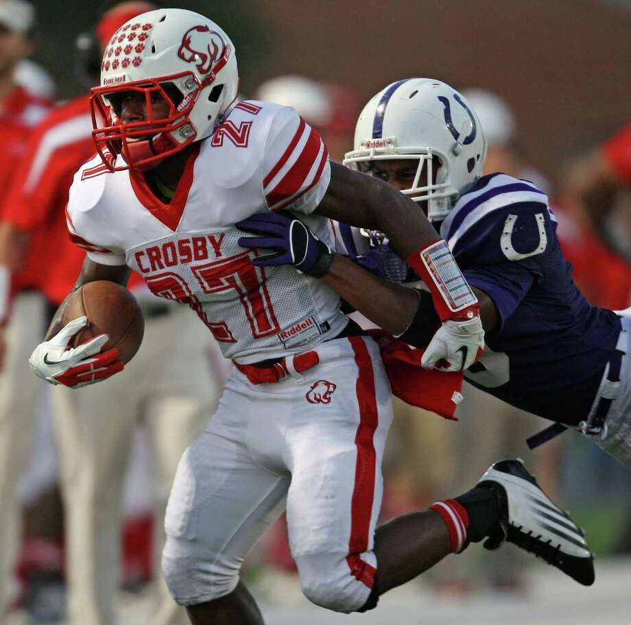 Crosby's Austin Walter (27) is tackled by Dayton's Donovon Jackson during the first half of a high school football game, Friday, September 21, 2012 at Bronco Stadium in Dayton, TX. Photo: Eric Christian Smith, For The Chronicle