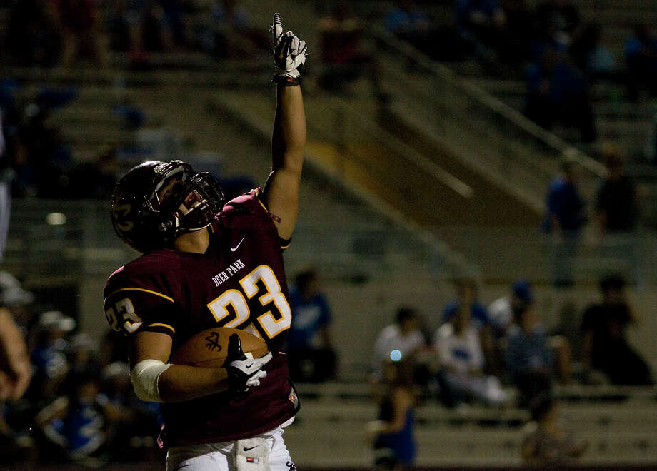 Deer Park's Noah Cano points to the sky after scoring his first touchdown of the game against Dickinson. (Joe Buvid/For the Chronicle) Photo: Joe Buvid, For The Chronicle / © 2012 Joe Buvid