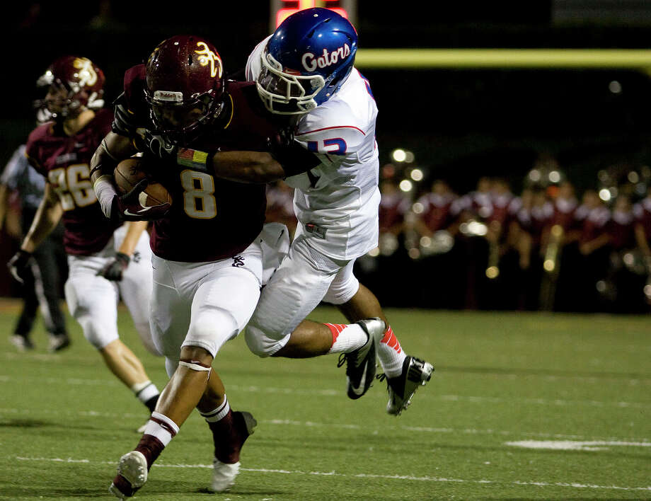 Deer Park's Eric Luna (8) is drought down after his reception by Dondre' Henderson (43) of Dickinson at Clyde Abshier Stadium on Friday, Sept. 21, 2012, in Deer Park. Photo: Joe Buvid, For The Chronicle / © 2012 Joe Buvid