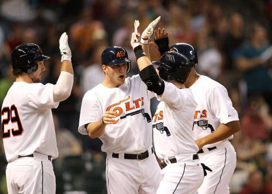 Jed Lowrie (4) celebrates his three-run home run. (Karen Warren / Houston Chronicle)