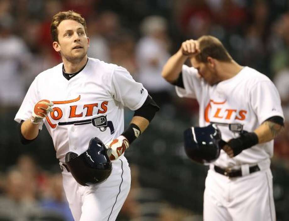 Jed Lowrie (4) celebrates his three-run home run with his teammates. (Karen Warren / Houston Chronicle)