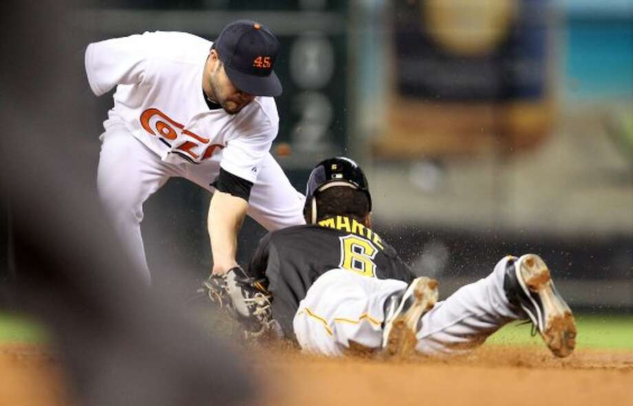 Jose Altuve (27) tags out Pirates left fielder Starling Marte (6) as he attempted to steal second base. (Karen Warren / Houston Chronicle)