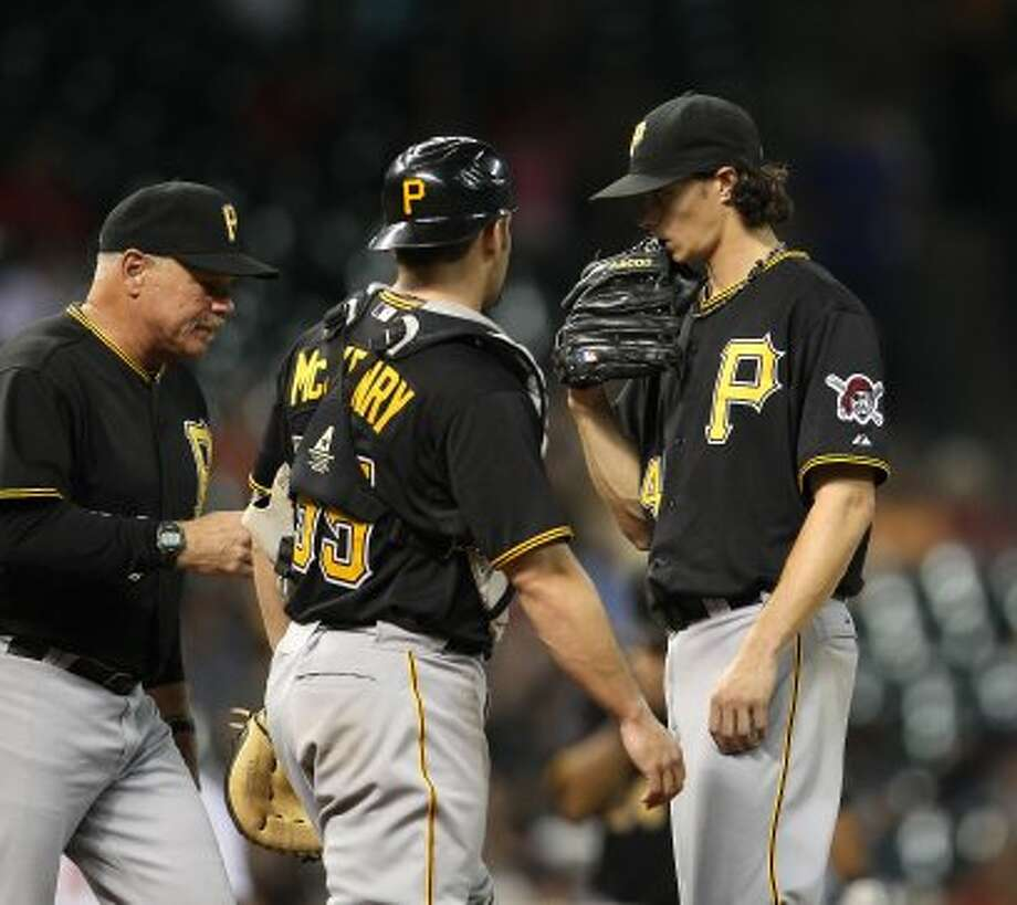 Jeff Locke (49) chats with pitching staff after walking Justin Maxwell (44) during the third inning. (Karen Warren / Houston Chronicle)