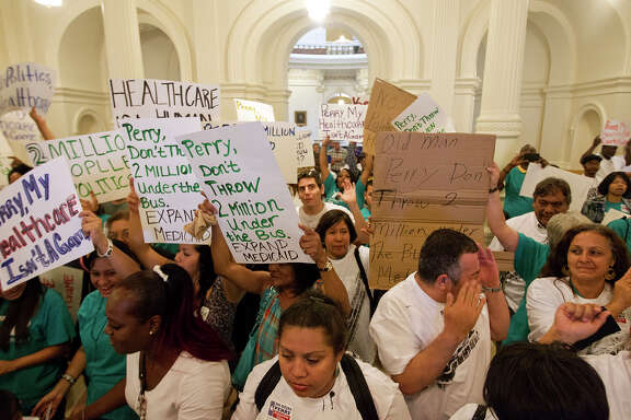 """Hundreds of people from Houston, Dallas, San Antonio and Austin unhappy at Gov. Rick Perryís shunning of an estimated $13 billion in federal funds, part of the Affordable Care Act or """"Obamacare,"""" that would expand Medicaid for up to 2.3 million Texans, according to state officials,  protest at the Capitol in Austin, Texas Friday, Sept. 21, 2012."""
