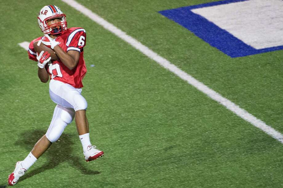 Lamar wide receiver Nicholas Turner hauls in a 41-yard touchdown pass during the fourth quarter against Elsik in a high school football game at Delmar Stadium, Friday, Sept. 21, 2012, in Houston. Photo: Smiley N. Pool, Houston Chronicle / © 2012  Houston Chronicle
