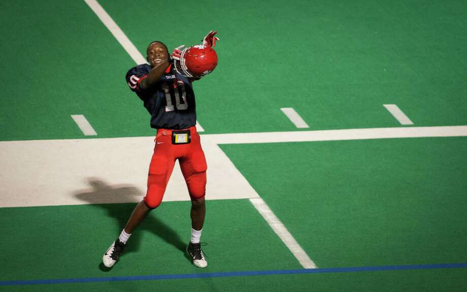 Alief Taylor defensive back Josh Kalu dances in celebration following the fourth quarter of a high school football game at Crump Stadium on Friday, Sept. 21, 2012, in Houston. Alief Taylor defeated Angleton 8-7. Photo: Andrew Richardson, For The Chronicle / © 2012 Andrew Richardson