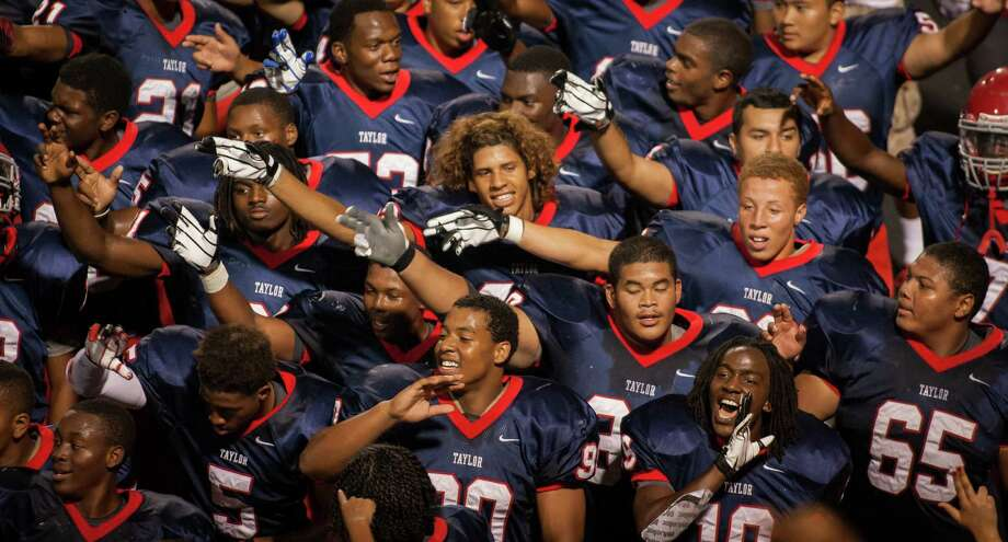 The Alief Taylor Lions wave as they sing their fight song following the fourth quarter of a high school football game at Crump Stadium on Friday, Sept. 21, 2012, in Houston. Alief Taylor defeated Angleton 8-7. Photo: Andrew Richardson, For The Chronicle / © 2012 Andrew Richardson